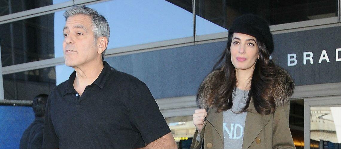 PHOTOS – Amal et George Clooney surpris à l'aéroport: est-elle enceinte?