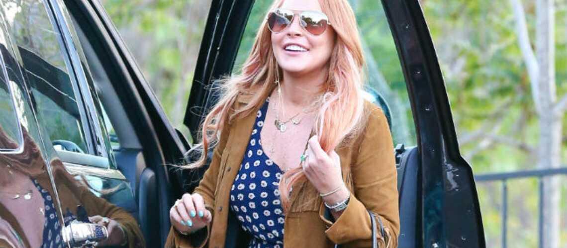 Photos- Lindsay Lohan sort de rehab avec le sourire